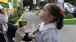 Swine flu spreads in world; Mexico opens schools
