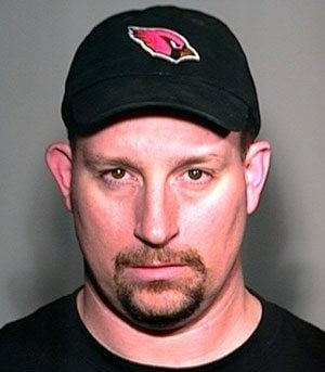 Cards fans arrested in burning McNabb's lawn