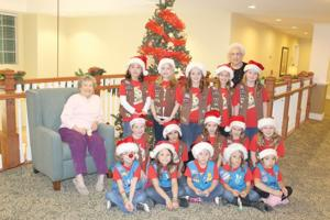 Local Brownie and Daisy troops bring joy with caroling