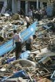 Wave rumors spark panic in tsunami zone