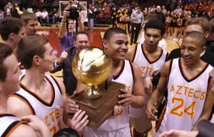 <p>The Corona del Sol boys basketball team celebrates its Division I championship win over Pinnacle at Jobing.com Arena, Saturday, Feb. 23, 2013 in Glendale.</p>