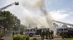 Firefighters battle Tempe house fire
