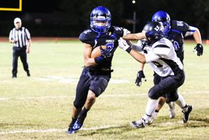 <p>Chandler running back Chase Lucas runs past Highland defenders during Chandlers 49-21 win Friday night.</p>
