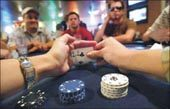 E.V. amateurs play Texas Hold'em as much for the chance to socialize as for the competition
