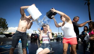 <p>David Perre and Kessa Switzenberg dump ice water on Angeline Fahey during the Ice Bucket Challenge to support ALS at T.C. Eggington's in Mesa on Sunday, Aug. 17, 2014. T.C. Eggington's Thom and Kathy Coker raised $3000 to support ALS.</p>