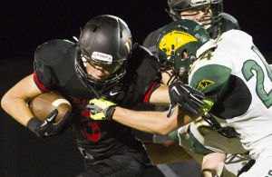 <p>Williams Field's running back Braedyn Bushman (3) pushes back Show Low's defensive back Jarom Fawcett (24) during the football game between Williams Field and Show Low at Williams Field High School on Friday, Aug. 22, 2014.</p>