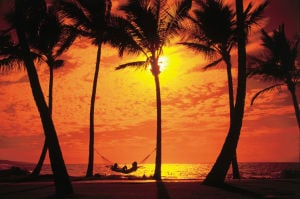 <p>Travelers will find warm tropical weather and beautiful sunsets in Hawaii this winter. (PRNewsFoto/Hawaii Visitors and Convention Bureau)</p>