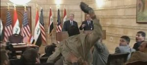 Journalist hurls shoes at President Bush during Iraq visit