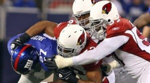 Cardinals' defense beats back Giants