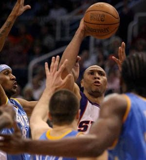 Marion scores 33 as Phoenix rallies past Denver, 125-108