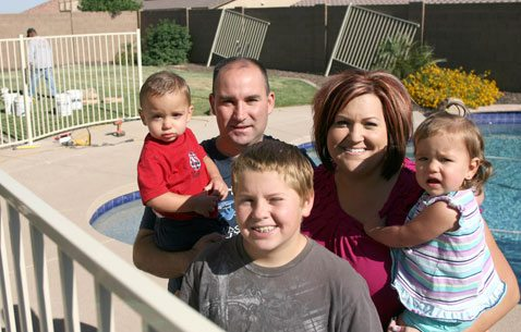 Family in need receives new fence for pool 