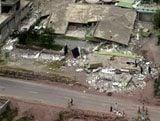 Rescuers try to reach Asia quake survivors
