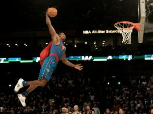 Orlando's Howard soars to spectacular dunk contest title