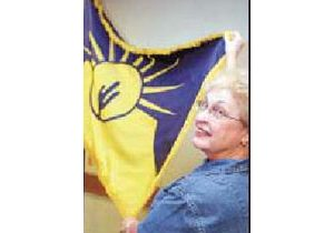 Winning flag in Tribune's contest adopted
