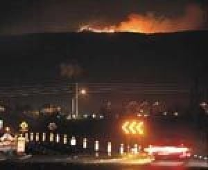 Firestorm pushes toward Rim country