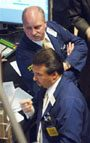 Dow Jones industrials close above 11,000