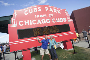 <p>Don and Nancy Smith pose in front of a replica of the Wrigley Field Marquee on opening day at Cubs Park in Mesa on Thursday, Feb. 27, 2014. The Chicago Cubs took on the Arizona Diamondbacks in the spring training game.</p>