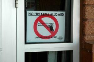 Guns allowed in some Arizona bars this week