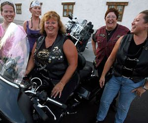 Women take the drivers seats on their own Harleys 