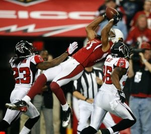Cards come up aces, top Falcons in playoffs