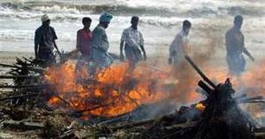 Asia rushes to bury bodies; death toll at 67,000