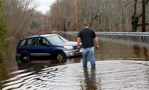 New England flooding drowns homes, dreams