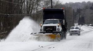 South blanketed with ice, snow; mid-Atlantic next