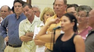 Tempers flare at health care town halls