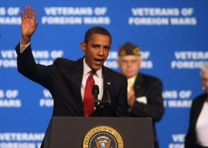 Obama slams wasteful spending in visit