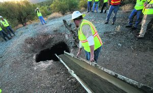 Volunteers fill in mine shafts near Gold Canyon