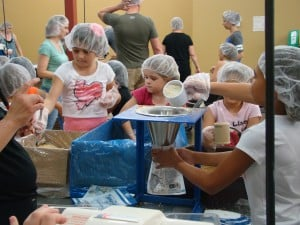 Riggs Elementary students make 4,000 meals for starving children
