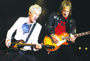 <p>Lead singer Kevin Cronin, left, and guitarist Dave Amato perform during an REO Speedwagon concert in 2009 in Paso Robles, Calif. The group, along with Chicago, will perform Saturday, Aug. 2, 2014, at  Comerica Theatre in Phoenix. (Michael A. Mariant/AP Photo)</p>