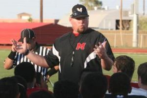 <p>Maricopa head coach Cory Nenaber talks to his team before a scrimmage at the high school's field in August.</p>