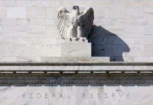 Fed extends housing plan, keeps rates steady