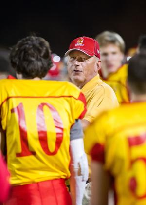 <p>Seton Catholic's Head Football Coach Rex Bowser talks to his QB on the sideline during the first round playoff game between Seton Catholic and Page HS at Seton Catholic High School in Chandler on Saturday, Nov. 8, 2014. [Greg Herriman / Special to Tribune]</p>