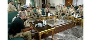 Commander briefs Bush from inside Saddam's palace