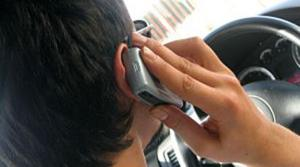 Bill bans cell phone use while driving
