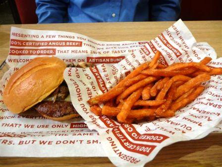 Smashburger sandwich and sweet potato fries