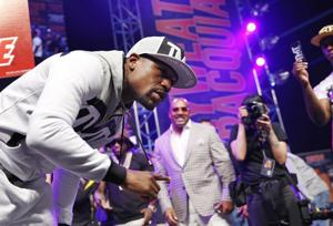 <p>Boxer Floyd Mayweather Jr. poses for photographers during an arrival ceremony Tuesday, April 28, 2015, in Las Vegas. Mayweather will face Manny Pacquiao in a welterweight boxing match in Las Vegas on May 2. (AP Photo/John Locher)</p>