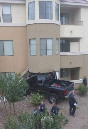 Truck crashes into Gilbert apartment
