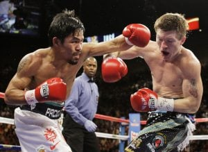Pacquiao stuns Hatton with second-round KO