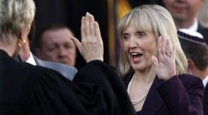 Oops - Brewer raises left hand for swearing-in