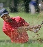 Tiger Woods easily captures 12th major title
