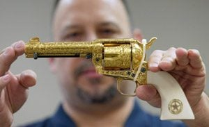 IRS to auction commemorative, gold-plated pistols
