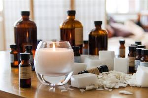 <p>This photo provided by Prosperity Candle shows Essential Oils and a Forever candle. The candle is hand made by Prosperity's corps of women artisans, who are able to earn a living wage and build a brighter future for their families. When the candle burns low it can be returned to Prosperity for a complimentary refill. Fragrances include vanilla bean and peppercorn, amber and orchid, and redwood and patchouli. (AP Photo/Prosperity Candle)</p>
