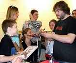 Two preteens perform with Tenacious D