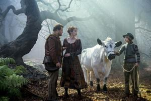 """<p>The Baker (James Corden) and his Wife (Emily Blunt) meet Jack (Daniel Huttlestone) and his cow, Milky Way, in the Woods, in Disney's """"Into the Woods.""""</p>"""