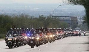 Thousands mourn loss of slain policeman