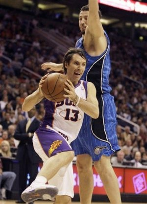 Suns work late Magic to win