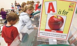Kids learn ABCs of fruits and vegetables